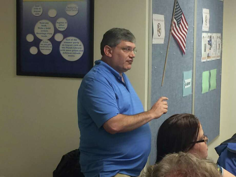 Mark Widomski, a Republican candidate for Shelton's Planning and Zoning commission, discusses a development during a recent Save Our Shelton meeting. Photo: / Michael P. Mayko