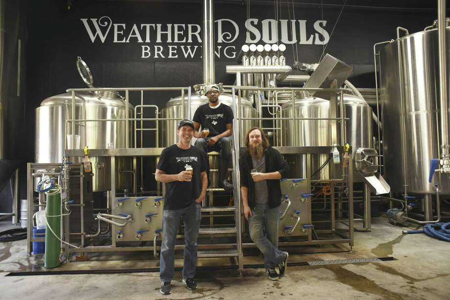Weathered Souls Brewing Co. co-founders Mike Holt, left, Marcus Baskerville and Seth Parker are about to celebrate one year in business. Their beer is sold at more than 75 locations throughout San Antonio. Photo: Billy Calzada /San Antonio Express-News / San Antonio Express-News