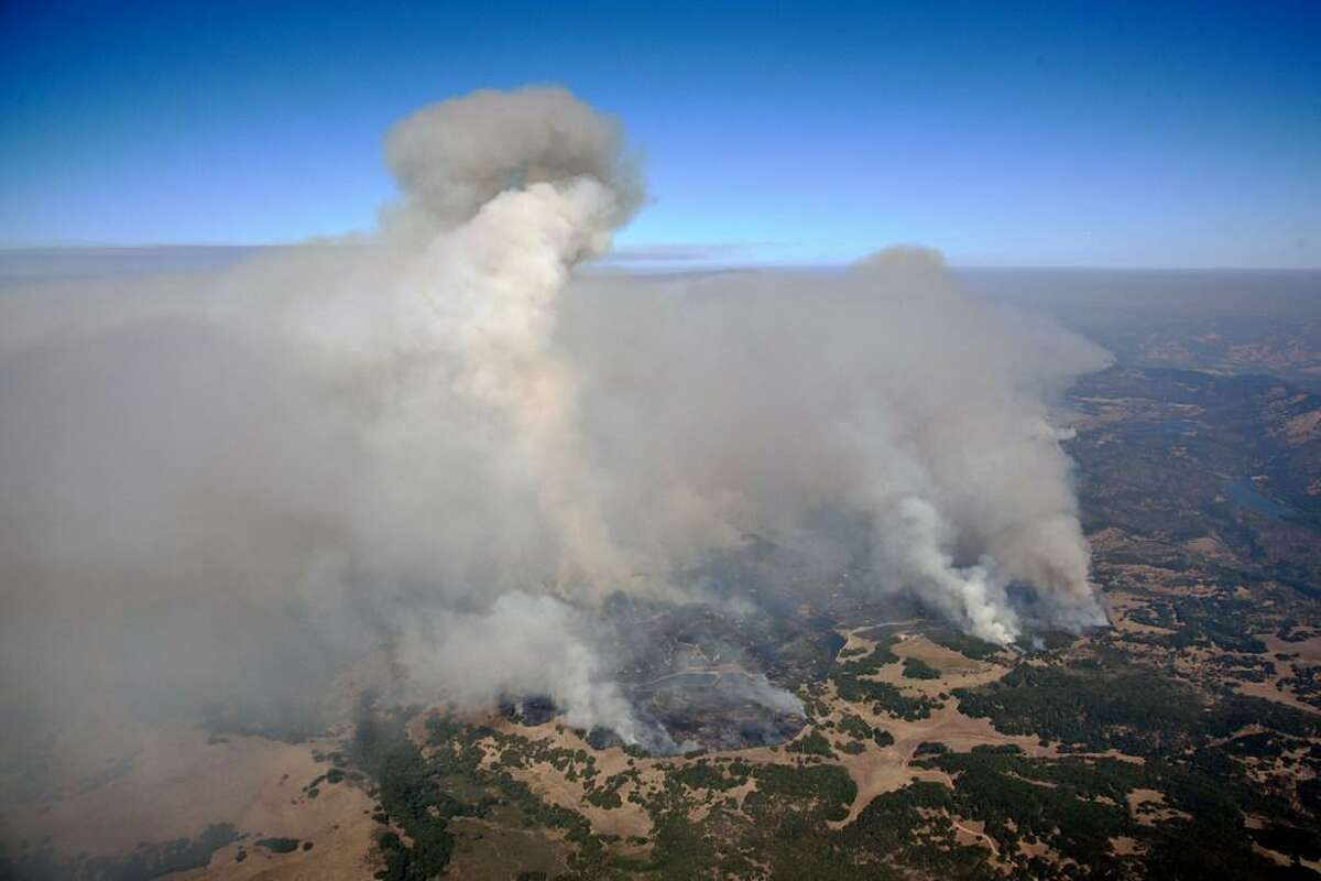 Smoke rises as a wildfire burns in the hills east of Napa, Calif., Monday, Oct. 9, 2017.