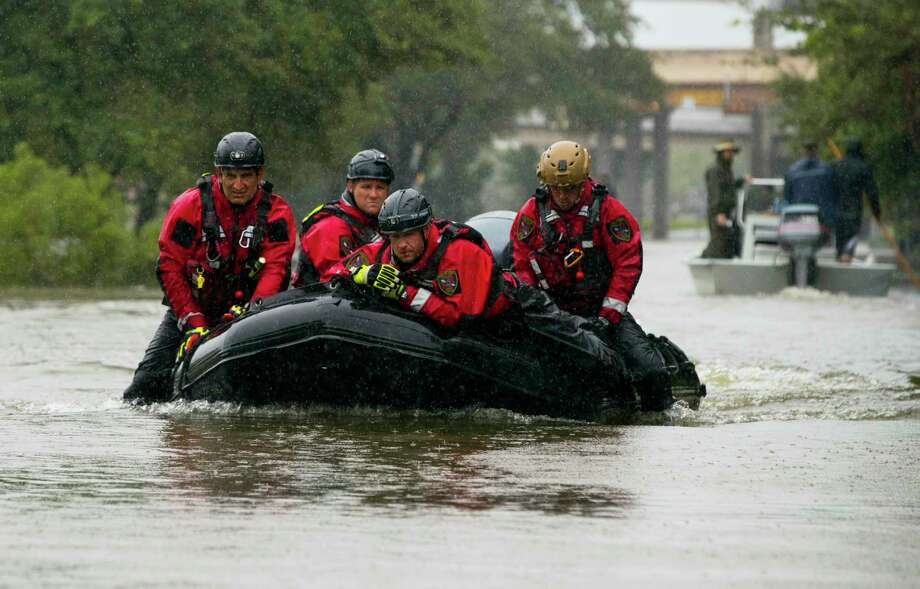 HOUSTON, TX - AUGUST 28:  Houston Fire Department Dive Team members motor through high water on North Braeswood Blvd in Houston, Texas looking for victims of the flooding from Hurricane Harvey August 28, 2017  (Photo by Erich Schlegel/Getty Images) Photo: Erich Schlegel, Stringer / 2017 Getty Images