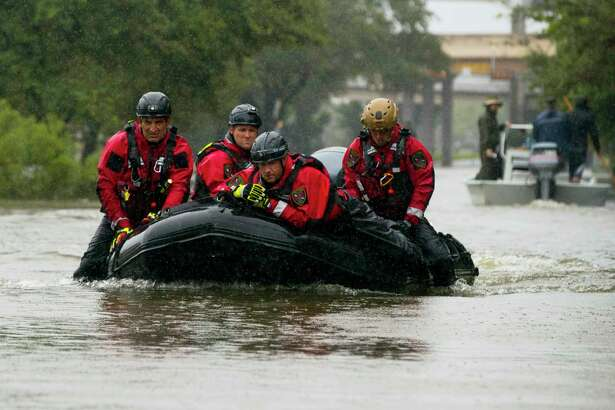 HOUSTON, TX - AUGUST 28:  Houston Fire Department Dive Team members motor through high water on North Braeswood Blvd in Houston, Texas looking for victims of the flooding from Hurricane Harvey August 28, 2017  (Photo by Erich Schlegel/Getty Images)