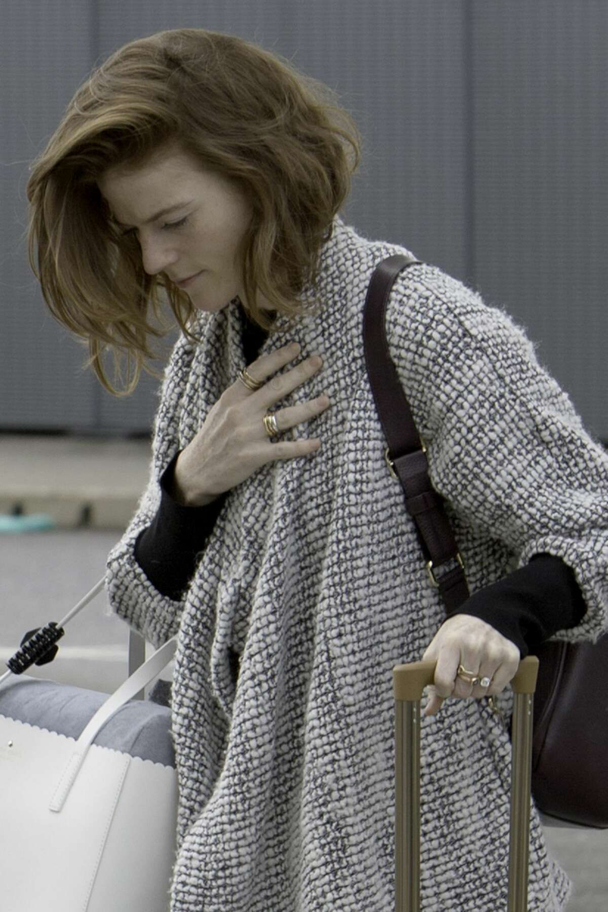 Actress Rose Leslie shows off her engagement ring as she arrives at Heathrow airport to catch a flight on October 8, 2017 in London, England.