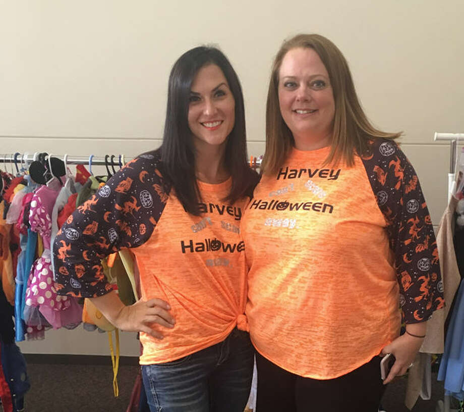 Katy moms Becky Schmidt, left, and Michelle Donahue have distributed so far  nearly 1,000 Halloween costumes through their Harvey Can't Scare Halloween Away! campaign. Photo: Becky Schmidt