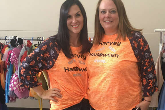 Katy moms Becky Schmidt, left, and Michelle Donahue have distributed so far  nearly 1,000 Halloween costumes through their Harvey Can't Scare Halloween Away! campaign.