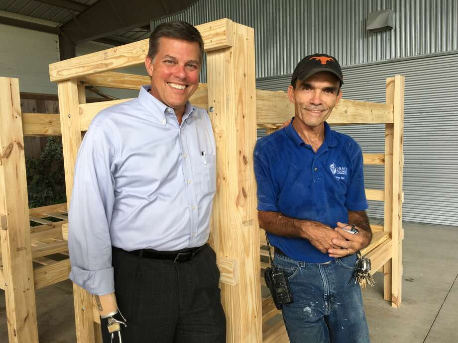 Bunk beds are being built at Grace Fellowship United Methodist Church for the volunteer work crews coming from throughout the country to help Katy-area residents rebuilt after Hurricane Harvey. From left are Mitchell F. Peairson, executive pastor, and Johnny Wood, chief engineer. Photo: Karen Zurawski