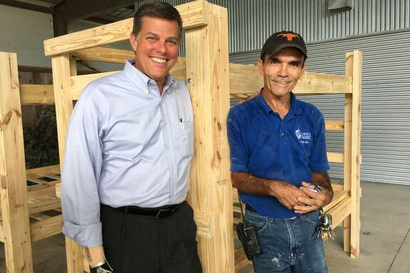 Bunk beds are being built at Grace Fellowship United Methodist Church for the volunteer work crews coming from throughout the country to help Katy-area residents rebuilt after Hurricane Harvey. From left are Mitchell F. Peairson, executive pastor, and Johnny Wood, chief engineer.