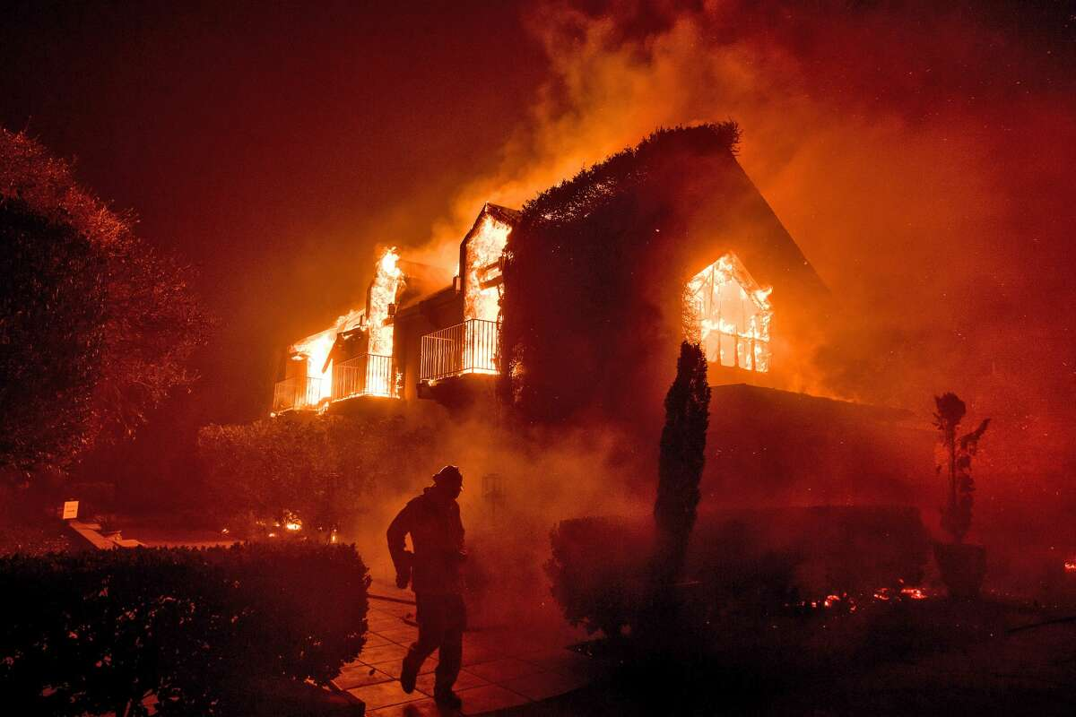 Flames consume a main building at the Signorello Vineyards in Napa, Calif., on Monday, Oct. 9, 2017.