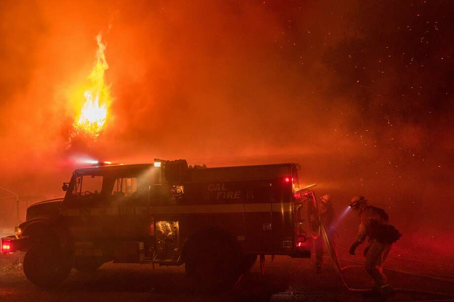 Firefighters work to save structures on Soda Canyon Road in Napa, Calif., on Monday, Oct. 9, 2017. Photo: Noah Berger/Special To The Chronicle