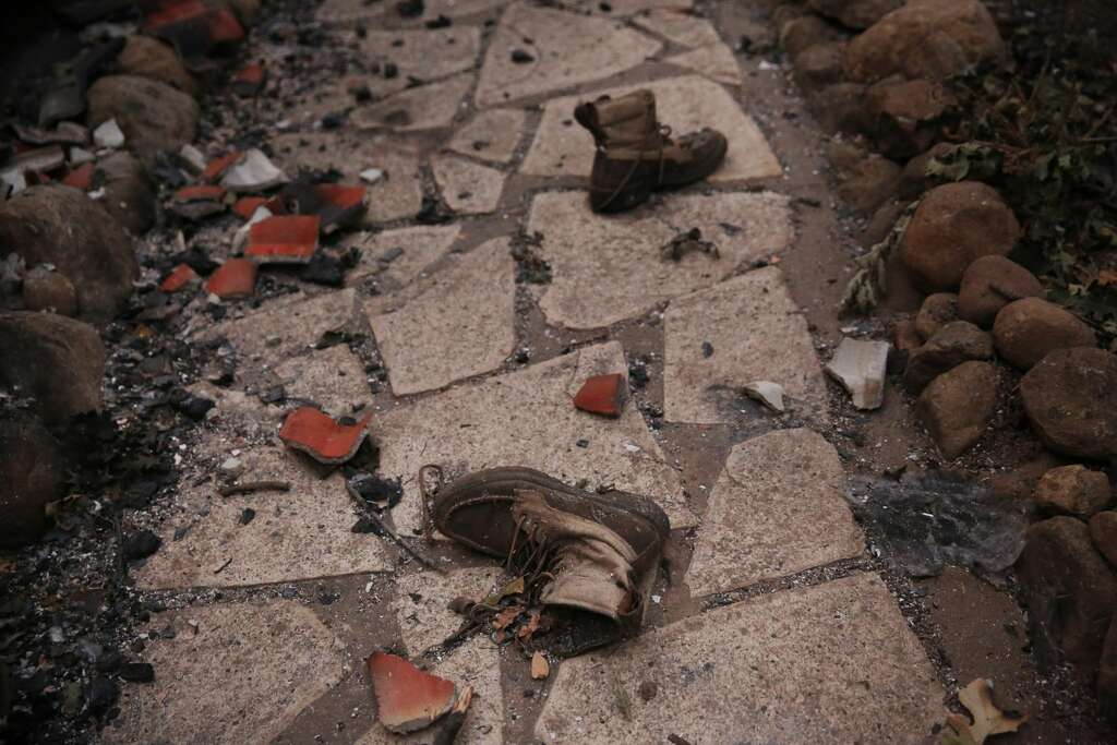 An Abandoned Pair Of Boots Lay Outside A Destroyed Home Off Soda Canyon Road Oct