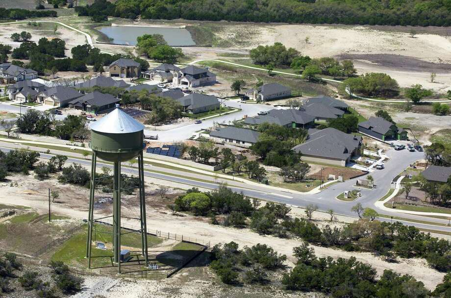 A Boerne city water tower stands Thursday, March 23, 2017 over a newer subdivision-style neighborhood indicative of a booming population in Kendall County, which grew 5.16 percent from July 1, 2015 and July 1, 2016 according to just-released Census numbers. That growth made Kendall the nation's second fastest growing county with more than 10,000 people during the period. Photo: William Luther, Staff / San Antonio Express-News / © 2017 San Antonio Express-News
