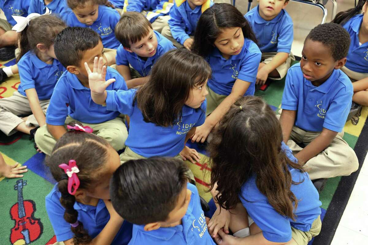 Classmates turn to look at Billy Taylor, right, as he answers a question during a kindergarten English lesson at IDEA Monterrey Park on the city's West Side, Thursday, Oct. 5, 2017. IDEA Public Schools received a $67 million grant from the U.S. Department of Education that will allow it to expand.