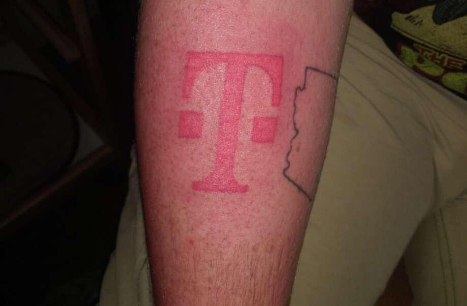 Philip Harrison's fresh T-Mobile tattoo. Photo:  (Twitter Photo / @philishadagrape)