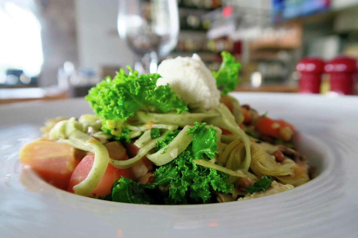 Kale linguine with sauteed mushrooms, artichoke hearts, toasted pine nuts, and garlic tossed with fresh tomatoes and olive oil  is among the new menu items at Mia Bella Trattoria.