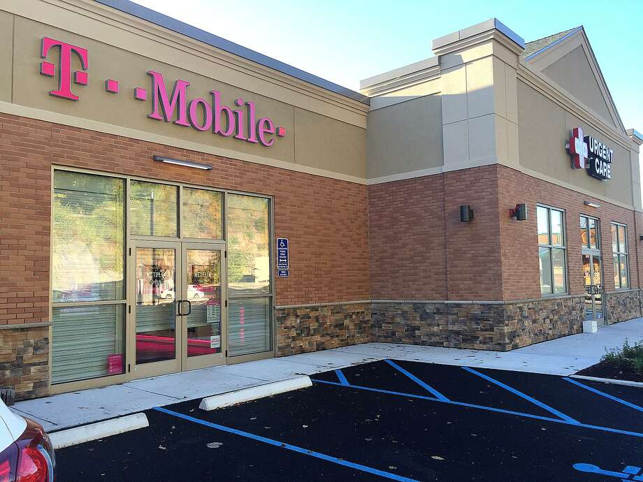 76 Newtown Road: T-Mobile has opened its third location in Danbury, the latest store being in the new plaza that also includes AFC Urgent Care and Aspen Dental. The newly developed lot on Newtown Road also includes Texas Roadhouse and Popeyes Louisiana Kitchen, which is slated to open later this year. T-Mobile, a provider of cell phones and cell service, also has two locations on Backus Avenue, one of which is in Danbury Fair mall. Photo: Chris Bosak / Hearst Connecticut Media / The News-Times