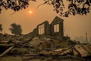 A wall stands at a Chanterelle Circle home destroyed by the Tubbs fire in the Fountaingrove area of Santa Rosa, Calif., on Tuesday, Oct. 10, 2017.