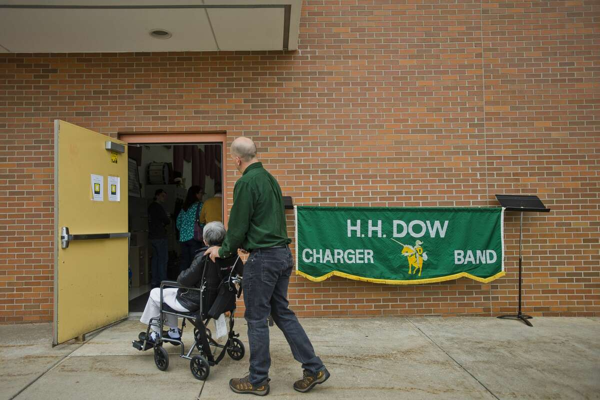 Alumni of the Dow High marching band arrive at the school for the band's 50th reunion celebration before Dow's homecoming football game against Arthur Hill on Friday, Oct. 6, 2017. (Katy Kildee/kkildee@mdn.net)