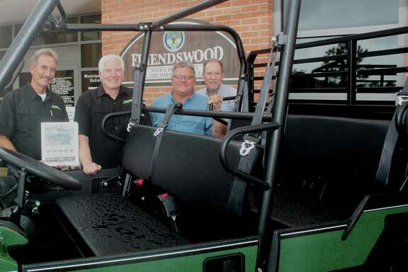 Garry Berry, left, and Bruce Gill of Kawasaki Motors Corp. present a utility vehicle to the city of Friendswood through dealer UVC Powersports of Alvin. Accepting the gift are Mayor Kevin Holland and City Manager Roger Roecker.