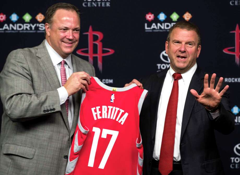 Houston Rockets CEO Tad Brown, left, and new team owner Tilman Fertitta hold up a Rockets jersey during a news conference introducing him as the Rockets new owner at Toyota Center on Tuesday, Oct. 10, 2017, in Houston. Photo: Brett Coomer, Houston Chronicle / © 2017 Houston Chronicle
