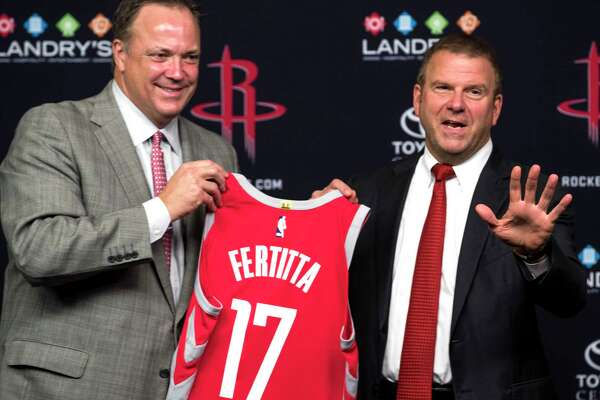 Houston Rockets CEO Tad Brown, left, and new team owner Tilman Fertitta hold up a Rockets jersey during a news conference introducing him as the Rockets new owner at Toyota Center on Tuesday, Oct. 10, 2017, in Houston.