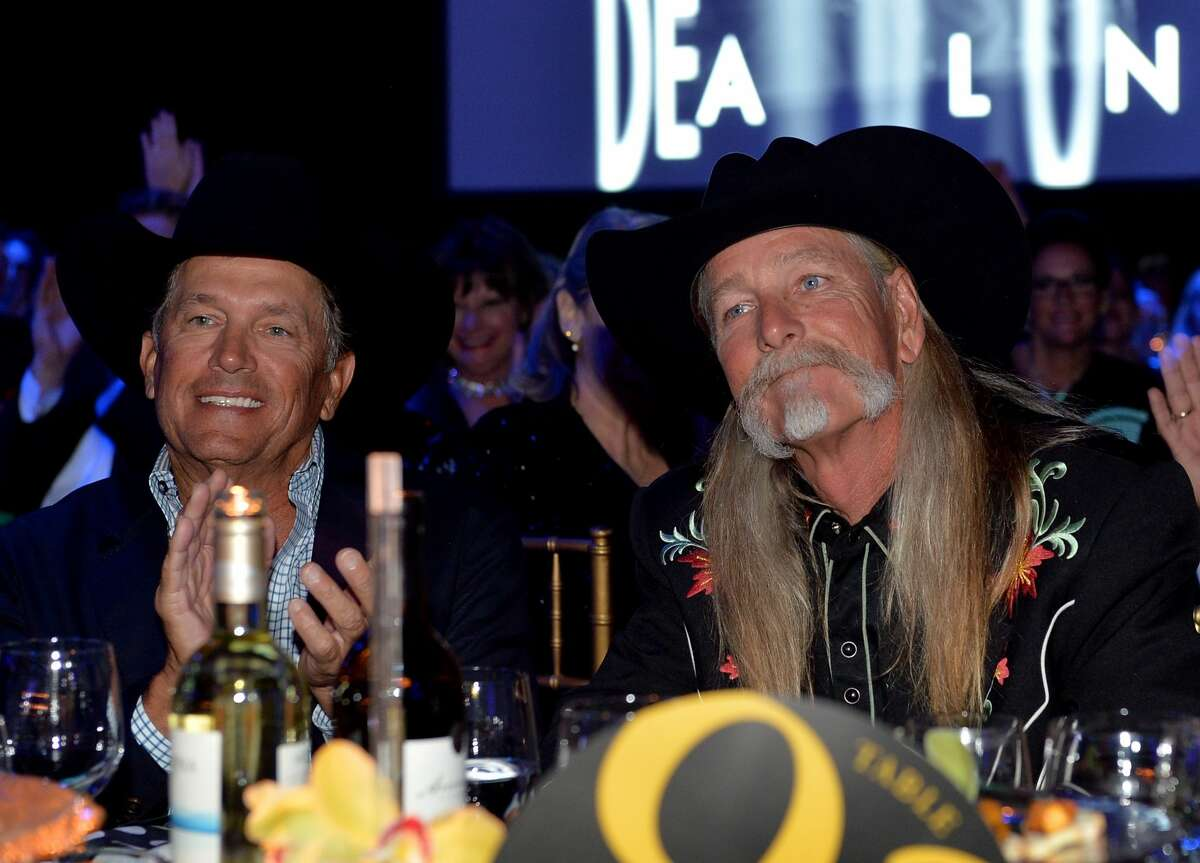 George Strait and Honoree Dean Dillon attend the 61st annual BMI Country Awards on November 5, 2013 in Nashville, Tennessee. See who else has written songs for the King of Country over the past few decades...