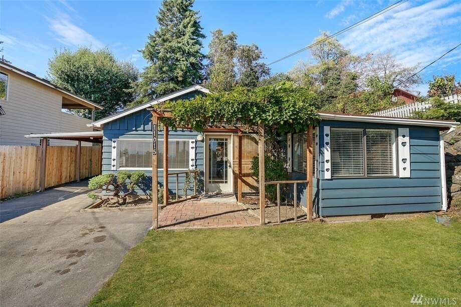 Close to the airport, city, and freeways, this one-bedroom has a fully fenced-in yard and gated entry. Plenty of new inside material, too: interior and exterior paint, bath and laundry room.The address is 11015 Sixth Ave. S., listed for $275,000. See the full listing below. Photo: Curt Bartowski/MyPhotosSellHomes.com