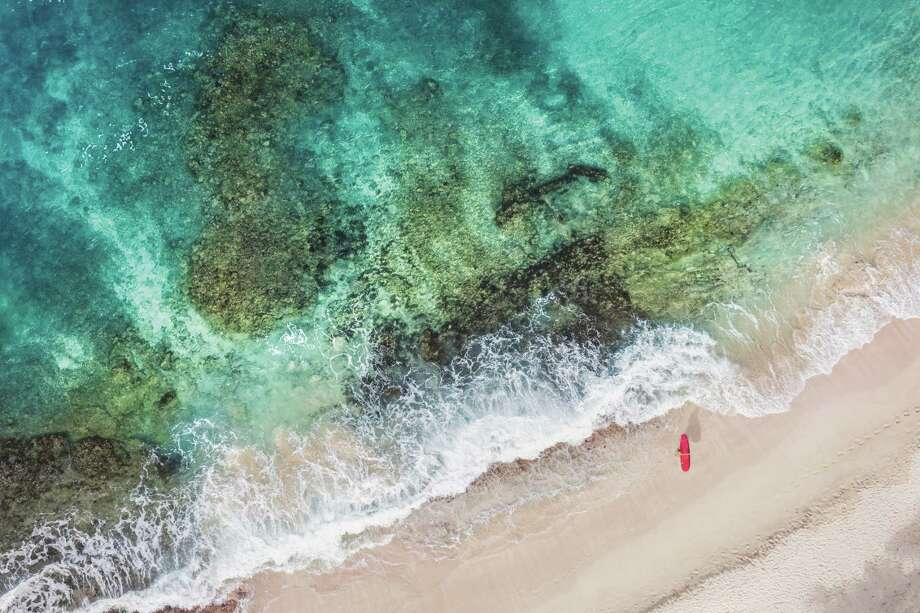 """""""St. Barths Red Surfboard,"""" from the """"A la Plage"""" series, is among the images in Gray Malin's recently released collection, """"Escape."""" Photo: Gray Malin. / Gray Malin"""