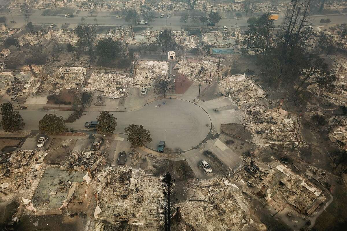 The remains of the homes in the Coffey Park neighborhood are seen from the air in Santa Rosa, Calif. on Tuesday, October 10, 2017.