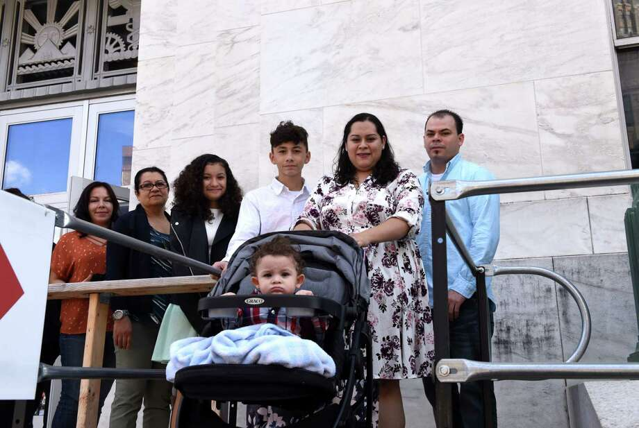 Jacki Cardenas, wife of Mario, left, Susana Alarcon Moscoso with her youngest daughter, Angela, Mario Cardenas' son, Christopher, 14, Jennifer Cardenas, second from right, her husband, Santos, right, and their 11-moth-old son, Dylan, center, leave the Federal Courthouse following acourt appearance for the of Guatemalan family on Tuesday, Oct. 10, 2017, in Albany, N.Y. (Will Waldron/Times Union) Photo: WILL WALDRON, Albany Times Union / 20041805A
