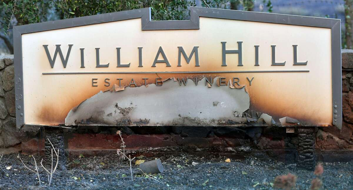 A partially burned sign is seen amidst smoldering remains at William Hill Estate Winery in Napa, California on October 9, 2017, as multiple wind-driven fires continue to whip through the region. / AFP PHOTO / JOSH EDELSONJOSH EDELSON/AFP/Getty Images