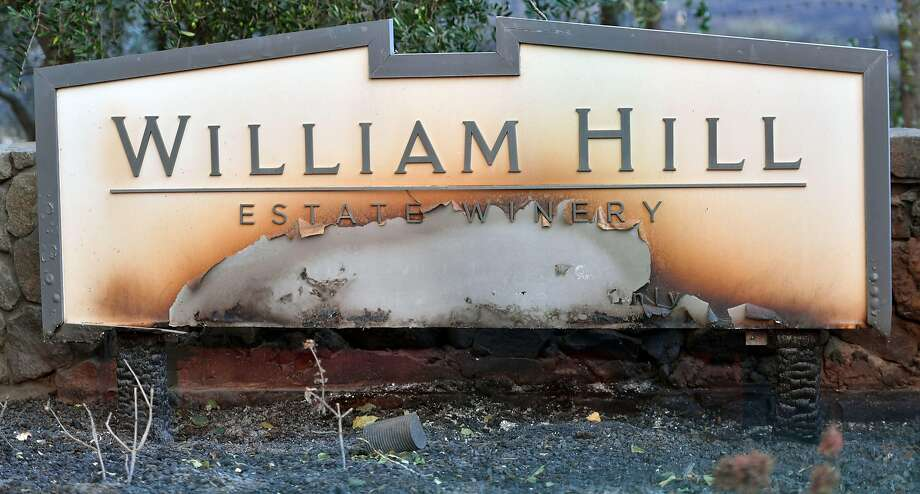 A partially burned sign is seen amidst smoldering remains at William Hill Estate Winery in Napa, California on October 9, 2017, as multiple wind-driven fires continue to whip through the region.  / AFP PHOTO / JOSH EDELSONJOSH EDELSON/AFP/Getty Images Photo: JOSH EDELSON, AFP/Getty Images