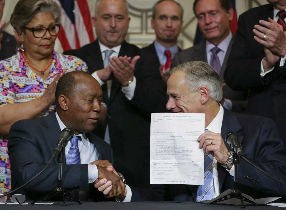 Gov.r Greg Abbott presents a $50 million dollar check from the state to Houston Mayor Sylvester Turner to assist the city with Hurricane Harvey relief during a joint press conference at Houston City Hall on Sept. 29. Why did the route to the solution have to be so drawn out? Photo: Yi-Chin Lee /Houston Chronicle / © 2017  Houston Chronicle