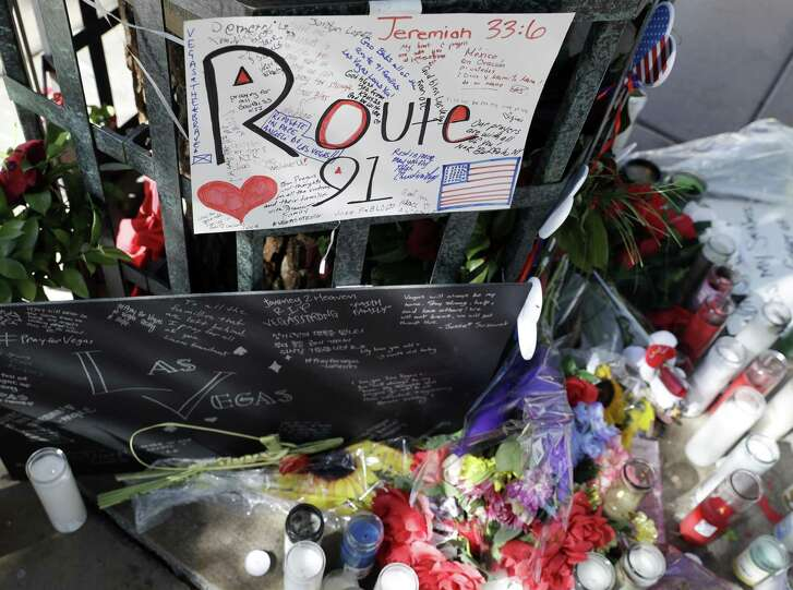 Flowers and signs are left at a memorial for the victims of a mass shooting in Las Vegas. After the shooting, survivors are grappling with a powerful emotion — guilt.