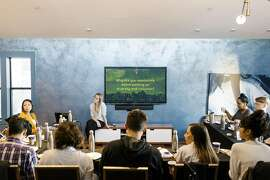 Joelle Emerson, next to screen, who runs a company called Paradigm that organizes diversity training for other companies, at a meeting in San Francisco, Sept. 22, 2017. After revelations of harassment and bias in Silicon Valley, a backlash is growing against the women in tech movement. The push for gender equality �created divides that I didn�t anticipate,� Emerson said. (Jason Henry/The New York Times)