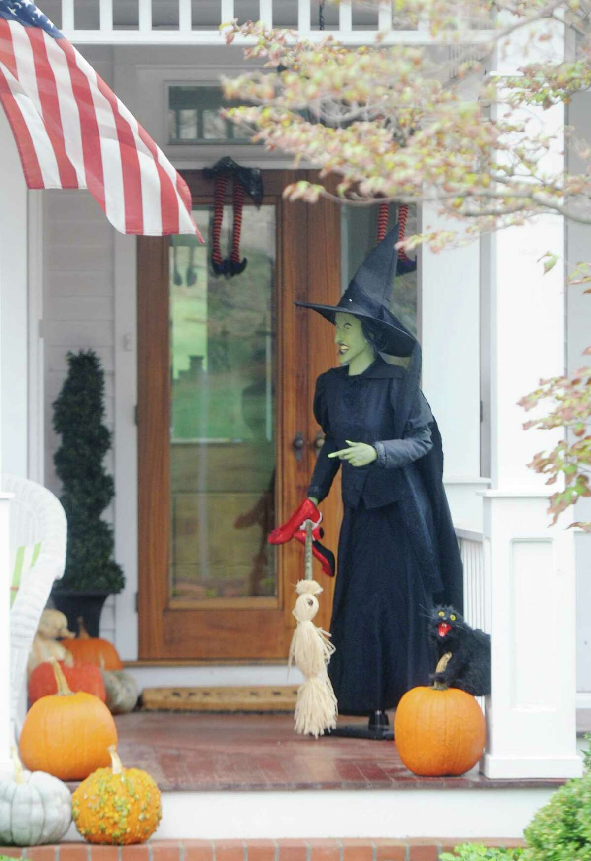A witch greets those who dare to enter this home on Steamboat Road in Greenwich, Conn. Monday, Oct. 9, 2017.