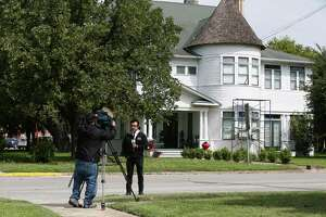 A television crew sets up a shot in front of the Daniels' residence in Seguin, Texas, Tuesday, Oct. 10, 2017. Texas Tech University freshman Hollis Daniels, 19, is accused of capital murder in the death of a university police officer, Monday night. Daniels grew up in Seguin and his family owns the Palace Theater where he worked.