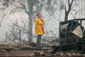 Mendocino Co. Sheriff Tom Allman walks through a home destroyed by fire on Tomki Road in Redwood Valley, Calif. on Tuesday Oct. 10, 2017. Authorities have reported at least three people have died and 50 residences have been destroyed by the Redwood Complex Fire.