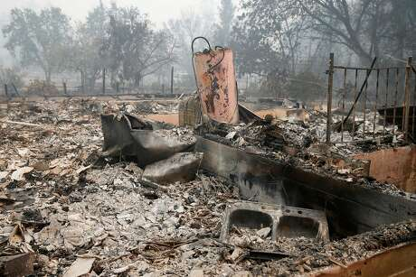 Charred rubble is all that remains of a home on East Road in Redwood Valley, Calif. on Tuesday Oct. 10, 2017. Authorities have reported at least three people have died and 50 residences have been destroyed by the Redwood Complex Fire.