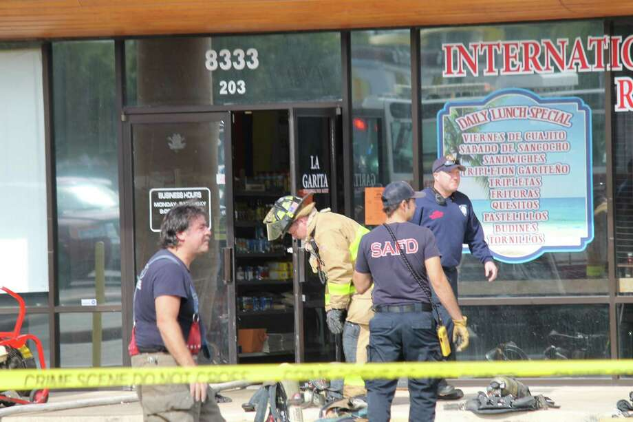Firefighters responded to a two-alarm fire at Big Harry's, a motorcycle shop in the 8300 block of Culebra Road. Photo: Fares Sabawi / San Antonio Express-News