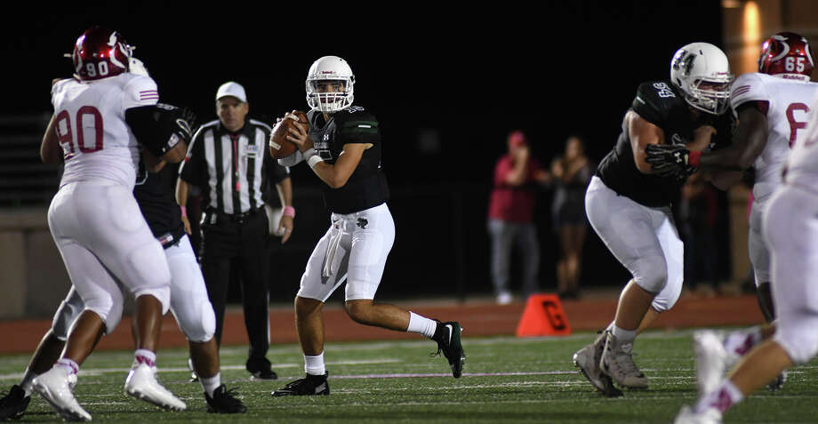 Kingwood Park senior quarterback Daniel Bresko, center, runs a play against Crosby defender Jamar Hamilton (90) during the 2nd quarter of their District 21-5A matchup at Turner Stadium in Humble on Oct. 6, 2017. (Photo by Jerry Baker/Freelance) Photo: Jerry Baker, Freelance / Freelance