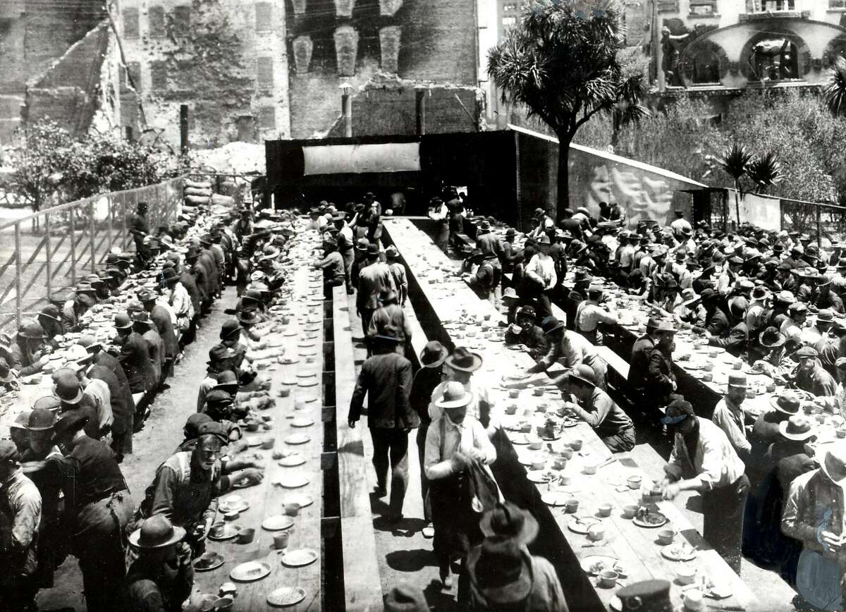 """Soup kitchens were set up all over town to feed hungry and homeless people. This one, known as the """"Crocker Restaurant"""" was in Union Square, and was apparently largely patronized by workmen and volunteers who were clearing rubble. Note the scars from flames on buildings at the rear. San Francisco EARTHQUAKE Ran on: 01-15-2005 The magnitude 8 temblor that hit on April 18, 1906, left large sections of San Francisco in ruins, but the official death toll was set at 478."""