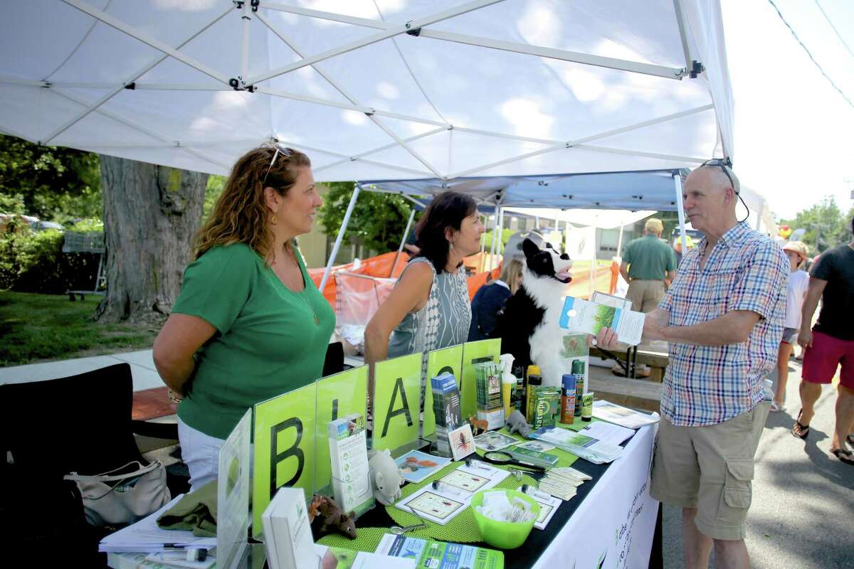 Derin Edip-Walden and Orna Grand from the Blast Lyme Disease Prevention Program speak to people about what they do during Wilton's 5th annual street fair and sidewalk sale on Old Ridgefield Road Saturday July 16, 2016.