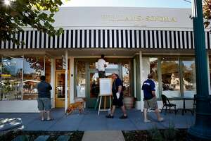 Workers and curious pedestrians walk by the new Williams Sonoma store on Broadway in Sonoma, Calif. Wednesday October 1, 2014. The Williams Sonoma new heritage store is opening at the site of the original shop in Sonoma, Calif. which opened in 1956.