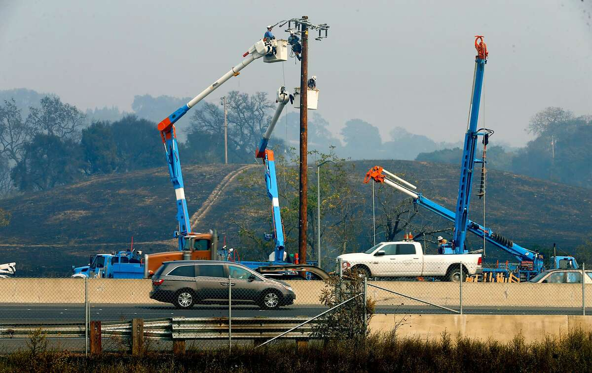 PG&E crews work to restore power along Old Redwood Road in Santa Rosa on Oct. 10.