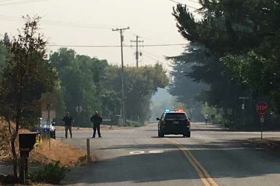 The California Highway Patrol closes , Green Valley Road at Rockville Road on Solano County during the Atlas Fire on Tuesday, October 10, 2017.