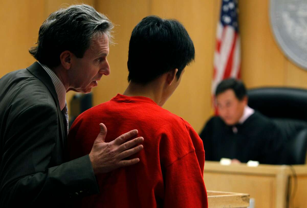 Attorney Mark Goldrosen talks to his client Binh Thai Luc, who pled not guilty to multiple counts of homicide during his arraignment in Judge Samuel Feng's courtroom at the Hall of Justice in San Francisco, Calif. on Thursday, April 5, 2012. Luc is accused of murdering five people at a home near City College last month.