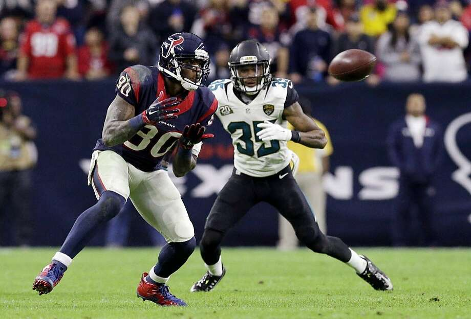 FILE- In this Dec. 28, 2014, file photo, Houston Texans wide receiver Andre Johnson (80) makes a reception as Jacksonville Jaguars cornerback Demetrius McCray (35) defends during the second half of an NFL football game in Houston. Johnson has been released by the Houston Texans, a person with knowledge of the move told The Associated Press, Monday, March 9, 2015. The person spoke on condition of anonymity because no formal announcement had been made by the team. Photo: Patric Schneider, AP