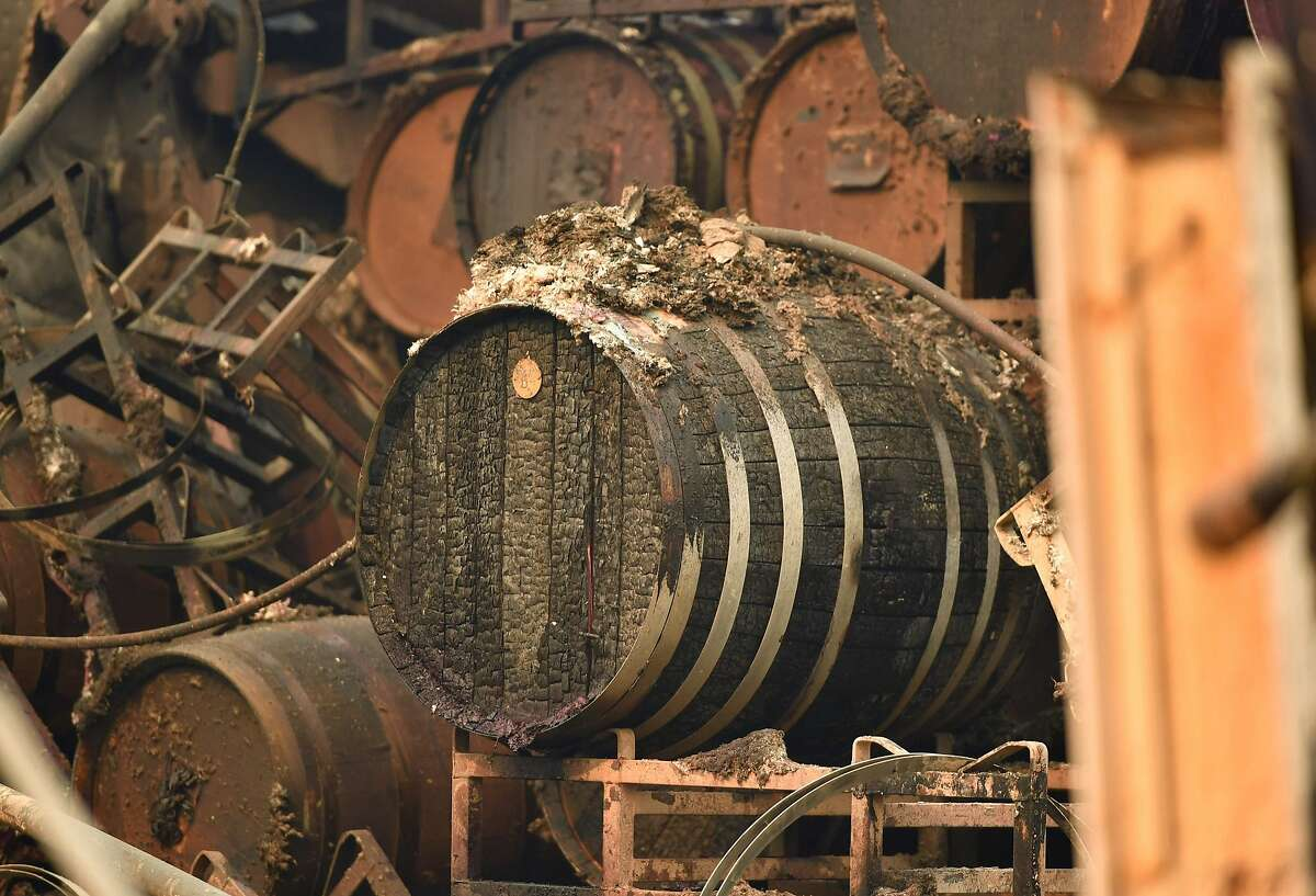 Burned wine barrels are seen at a destroyed Paradise Ridge Winery in Santa Rosa, California on October 10, 2017. Firefighters encouraged by weakening winds were battling 17 large wildfires on Tuesday in California which have left at least 13 people dead, thousands homeless and ravaged the state's famed wine country. / AFP PHOTO / JOSH EDELSONJOSH EDELSON/AFP/Getty Images