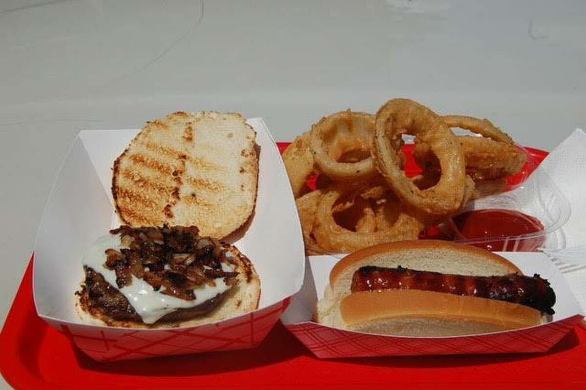 Above, a hamburger, hot dog and outstanding onion rings at Dog Daze Cafe, where diners eat al fresco. Below, fresh fruits and an array of jams and jellies are available to buy at Dog Daze.