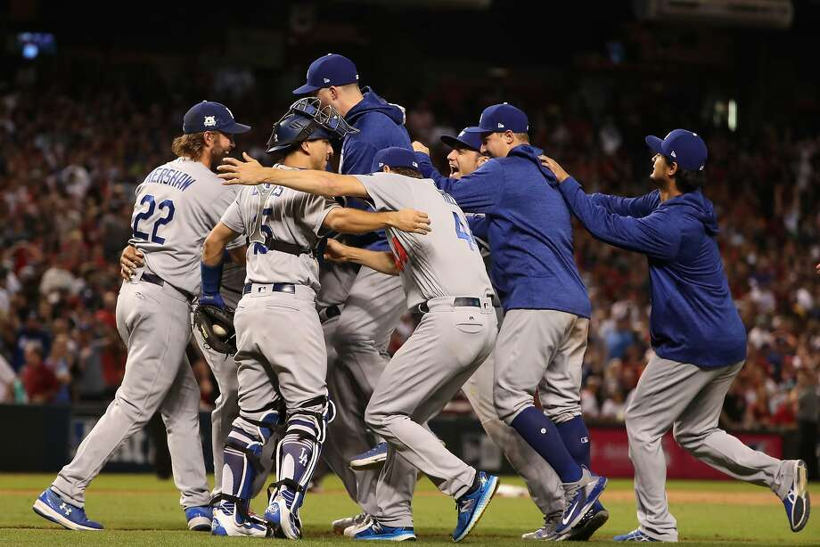 Clayton Kershaw (22) and the Dodgers celebrate sweeping the Diamondbacks in the NLDS on Monday night. On Saturday, Kershaw will start Game 1 of the NLCS on seven days' rest. Photo: Christian Petersen, Getty Images