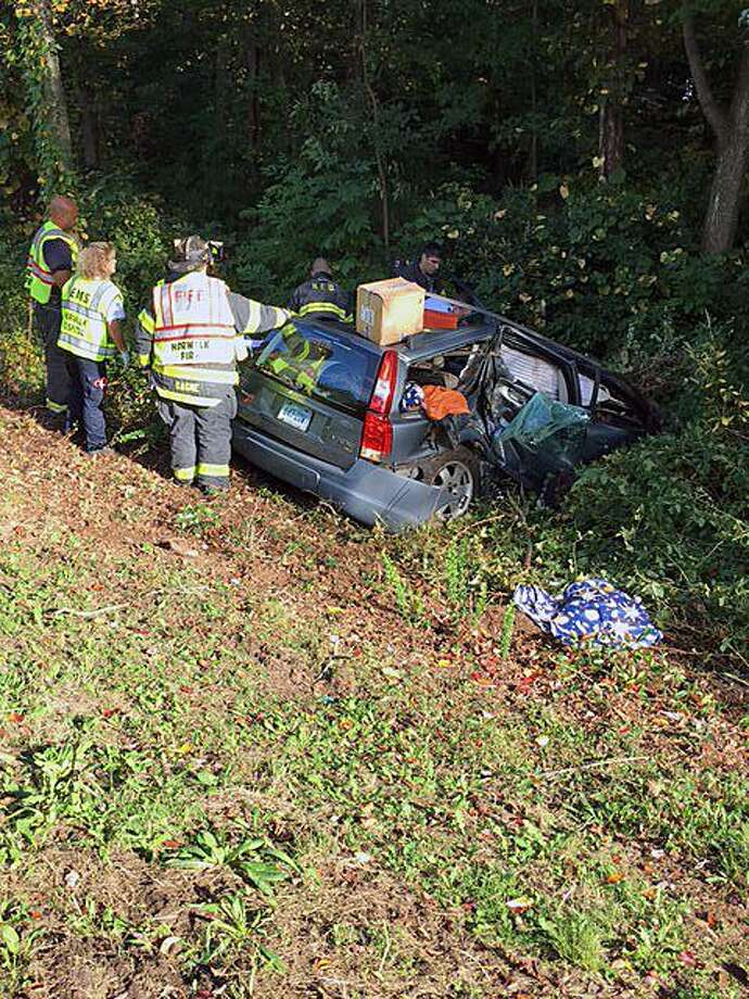 The Norwalk Fire Department responded to the parkway between exits 40 and 41 northbound around 4 p.m. on Tuesday, Oct. 10, 2017, in Norwalk, Conn., according to Deputy Chief Edward Prescott. He said a woman in her 50s was transported to Norwalk Hospital with non-life-threatening injuries. Photo: Contributed Photo / Norwalk Fire Department / Contributed Photo / Connecticut Post Contributed